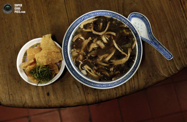 Snake meat is seen in a bowl of snake soup served at a snake soup shop in Hong Kong