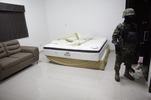 "A Mexican Marine stands in the bedroom of one of the houses of Joaquin ""Chapo"" Guzman during a presentation for the media in Culiacan"